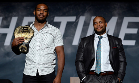 LAS VEGAS, NEVADA - NOVEMBER 17:  UFC light heavyweight champion Jon Jones (L) and challenger Daniel Cormier pose for the media during the UFC Time Is Now press conference at The Smith Center for the Performing Arts on November 17, 2014 in Las Vegas, Nevada. (Photo by Jeff Bottari/Zuffa LLC/Zuffa LLC via Getty Images)